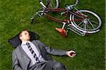 Businessman Lying on Grass