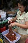 Bagging Chilli crispy pork on a street stall, Asia