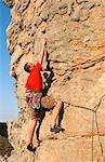 Man Climbing Cliff Face