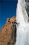 Woman Abseiling Down a Frozen Waterfall