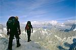 Hikers Crossing L'Aiguille du Midi - 3842m Rocky Outcrop