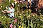 Mature Woman Tending Her Rose Garden