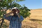Tourists Looking Through Binoculars in the Palmwag Rhino Camp