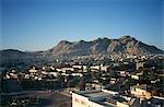 Portrait of a City Against a Mountain