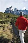 Tourist Hiking on a Remote Mountain Path