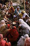 Women performing puja on the river front, Varanasi (Benares), Uttar Pradesh state, India, Asia