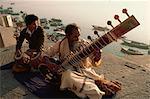Sitar and tabla player beside the Ganga River, Varanasi, Uttar Pradesh state, India, Asia