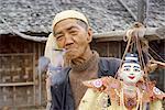 Puppeteer smoking cheroot with his puppets, Yangon (Rangoon), Myanmar (Burma), Asia