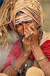 Portrait of a Sadhu or holy man smoking a pipe, in Kathmandu, Nepal, Asia
