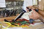 Close-up of Man Making a Shoe, Maida's Black Jack Boot Company, Houston, Texas, USA