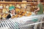 Baker Handling Tray of Baked Goods