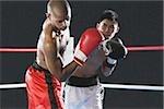 Japanese boxer hitting his opponent