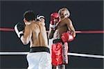 Two men fighting in Boxing ring