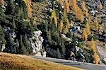 Road Biker riding downhil, Dolomites