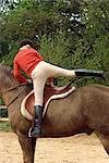 Teenage girl mounting horse, England, United Kingdom, Europe