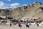 Game of polo on Leh polo field, Tsemo Gompa on ridge behind, Leh, Ladakh, India, Asia