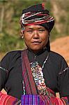 Ann lady with textiles, Ann village, Kengtung (Kyaing Tong), Shan state, Myanmar (Burma), Asia