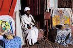 Priest holding cross inside Bet Gabriel-Rufael, Lalibela, Ethiopia, Africa