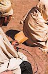 Pilgrim reads Holy Bible in Bet Maryam (St. Mary's) courtyard, Lalibela, Ethiopia, Africa