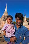 Father carries his daughter to the festival, Ananda festival, Old Bagan, Bagan (Pagan), Myanmar (Burma), Asia