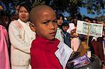 Novice monk collecting alms, Ananda festival, Ananda Pahto (Temple), Old Bagan, Bagan (Pagan), Myanmar (Burma), Asia