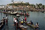 Fishermen bringing catch ashore, Elmina, Ghana, West Africa, Africa