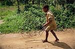 Boy playing with hoop, Kabale, Uganda, Africa