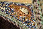 Lion decoration on portal of the 17th century Sher Dor Madressa, Registan Square, Samarkand, Uzbekistan, Central Asia, Asia