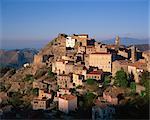 Clifftop village of Speloncato, in dusk light, Balagne region, Corsica, France, Europe