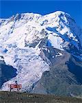 Hiker on bench, The Breithorn and Breithorn Glacier, Rotenboden, Zermatt, Valais, Switzerland, Europe
