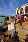 Unloading fruit in main food market, Samarkand, Uzbekistan, Central Asia, Asia