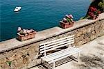 Empty bench at seaside, Bay of Naples, Sorrento, Sorrentine Peninsula, Naples Province, Campania, Italy