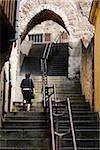 Rear view of a woman moving up on staircase, Escalier de la Grande Poterne, Le Mans, Sarthe, France