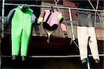 Wetsuits hanging on a pipe, Cinque Terre National Park, RioMaggiore, Cinque Terre, La Spezia, Liguria, Italy