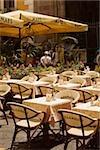 Tables and chairs at a sidewalk cafe, Via Padre Reginaldo Giuliani, Sorrento, Sorrentine Peninsula, Naples Province, Campania, Italy