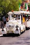 Tourist in a conch tour train, Sorrento, Sorrentine Peninsula, Naples Province, Campania, Italy