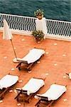 High angle view of empty lounge chairs with a patio umbrella, Positano, Amalfi Coast, Salerno, Campania, Italy