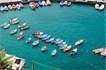 Boats docked at harbor, Italian Riviera, Cinque Terre National Park, Il Porticciolo, Vernazza, La Spezia, Liguria, Italy