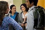 University students talking in a corridor