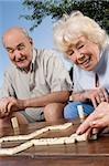 Senior couple playing dice game