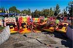 Trajineras boats moored in a canal, Xochimilco Gardens, Mexico City, Mexico