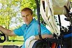 Man in Golf Cart