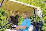 Hommes en voiturette de Golf