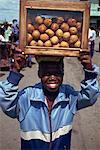 Boy selling bean cakes, Monrovia, Liberia, West Africa, Africa