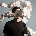 man standing in a cloud of smoke