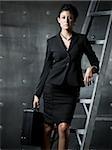 businesswoman on a ladder