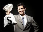 businessman holding a bag of money