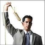 businessman with hangman's noose around his neck