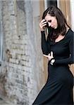 Sad woman wearing black dress