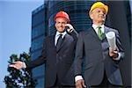 Two businessman wearing hardhats